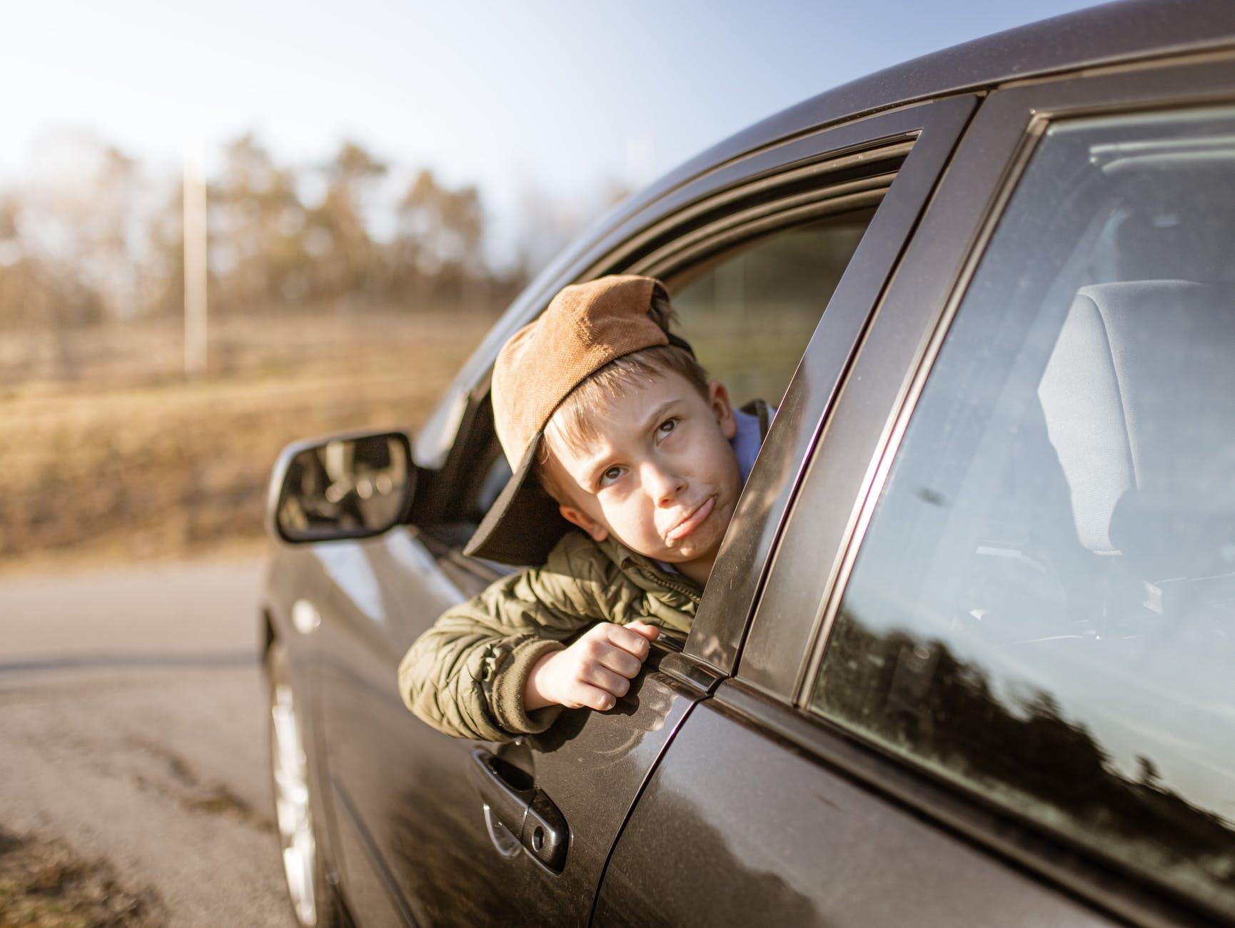 kid s head on car window